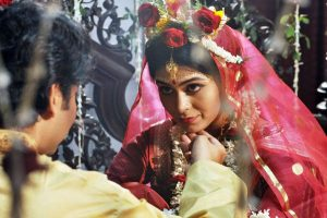 A still from 'Onyo Opalaa' featuring Bhaswar Chatterjee & Ritabhari.